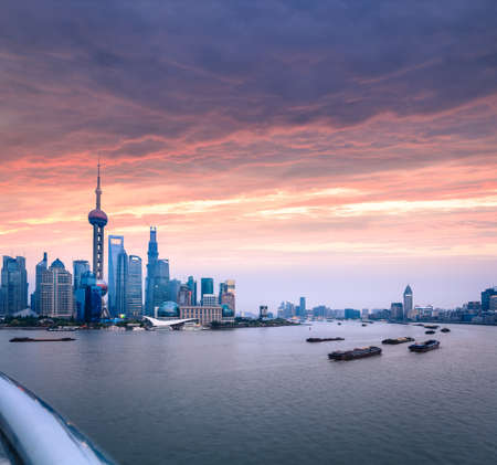 shanghai skyline with beautiful huangpu river in sunset glow photo