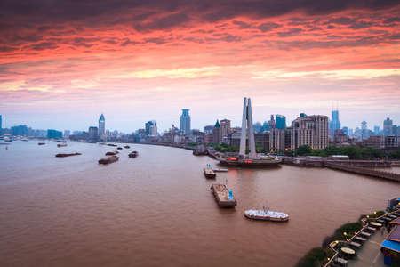 美しい夕焼けと外灘の上海 写真素材