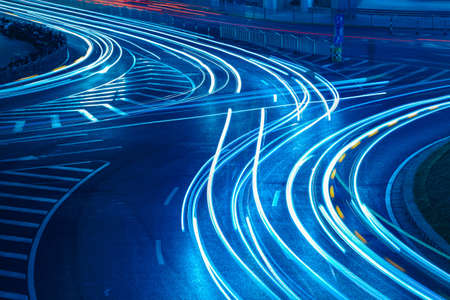 light trails on the urban road,abstract background