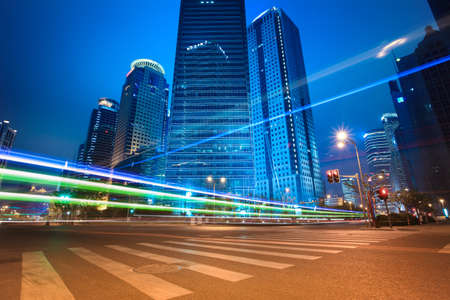 urban road: urban road car light trails of modern buildings at night in shanghai,China Stock Photo