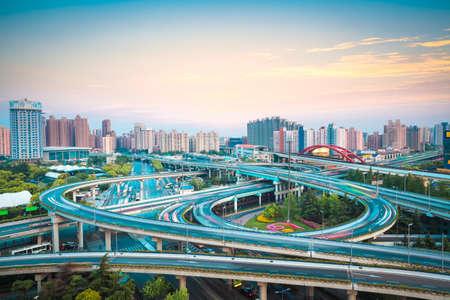 interchange overpass at dusk in shanghai photo