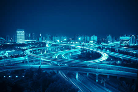 interchange in shanghai at night,clover stack type overpass with blue tone