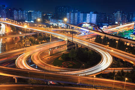 interchange in shanghai at night,clover stack type overpass photo