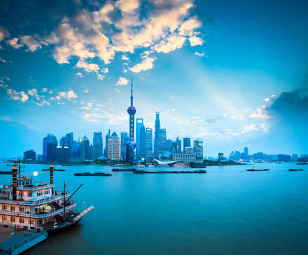 beautiful shanghai at dusk,pudong skyline with huangpu river and pleasure boat,China  photo
