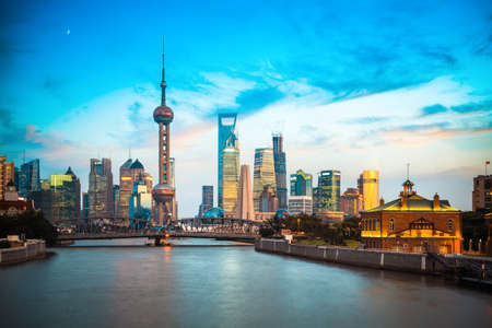 shanghai skyline and suzhou river in sunset glow