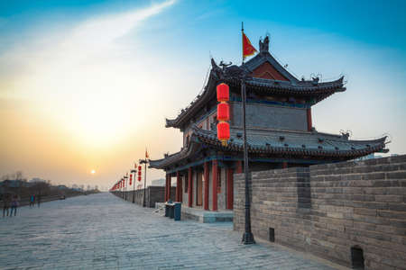 china landscape: ancient tower on city wall at dusk in Xi