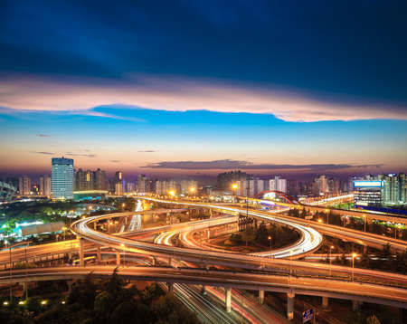beautiful city interchange overpass at nightfall in shanghai photo