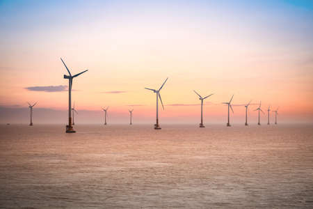 turbines: offshore wind farm at dusk in the east China sea. Stock Photo