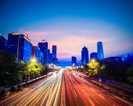 nightfall: beijing central business district with traffic in nightfall,China