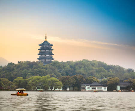hangzhou scenery,pagoda on the west lake lakefront in dusk photo