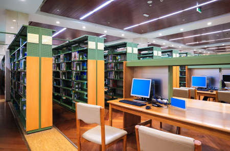 night school: modern library interior,library setting with books and computers