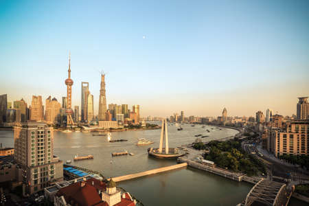beautiful shanghai at dusk,panoramic of pudong skyline and the bund with huangpu river Imagens