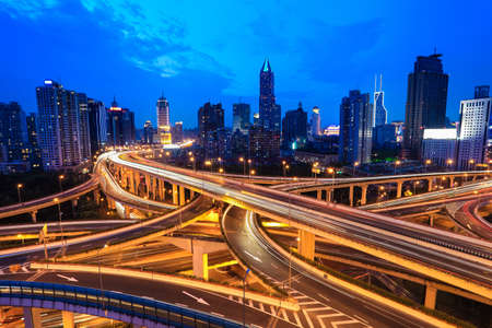interchange: beauty of shanghai in the evening, puxi skyline and yan an east road overpass