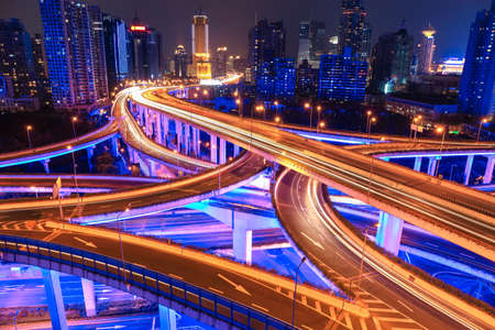 overpass: colorful city interchange overpass at night in shanghai,China Stock Photo