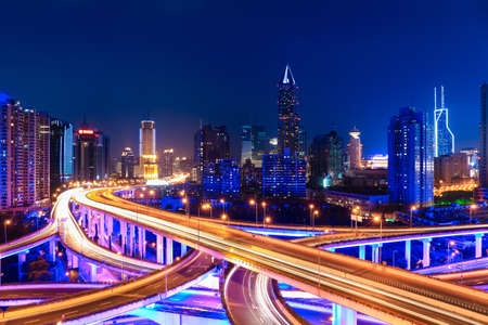 modern city skyline with interchange overpass in shanghai at night,China