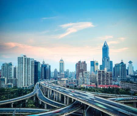 future city: modern grade separation viaduct in shanghai at dusk,China