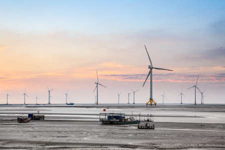 wind turbine generating electricity in seashore,develop shoals. Stock Photo - 22283630