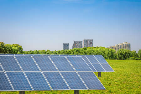 solar panels in the park of modern city,clean energy concept Stock Photo