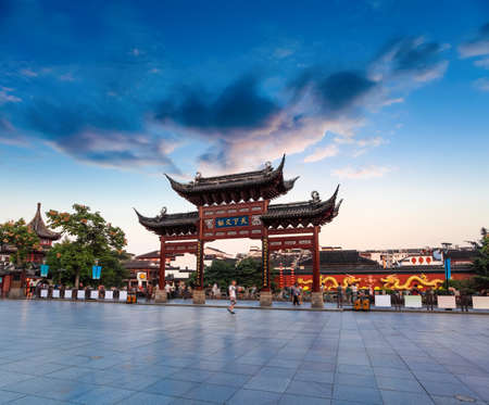 riverside landscape: memorial arch in nanjing confucius temple at dusk,China. Stock Photo
