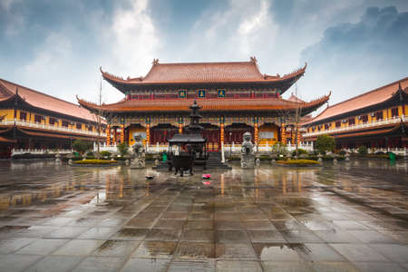 buddhist temple roof: chinese temple building in cloudy Editorial