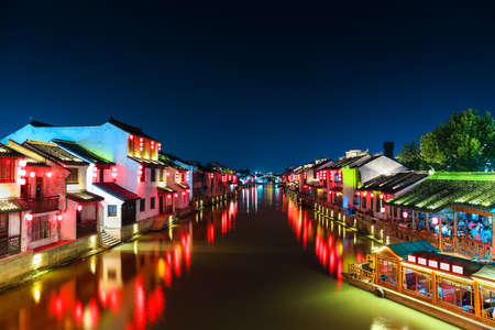 ancient town with grand canal of yangtze river delta at night in wuxi city,China