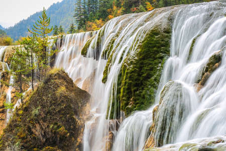 pearls beach waterfall in autumn at jiuzhai valley national park, sichuan, China. photo