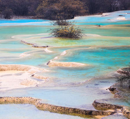 calcification: colorful travertine ponds in huanglong , sichuan , China.
