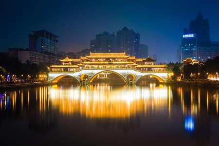 covered bridge: anshun bridge in chengdu at night , China.