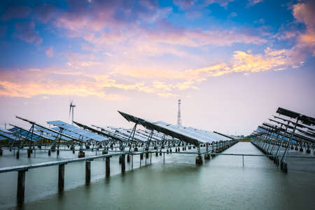 photovoltaic: solar and wind power in sunset,green energy background.
