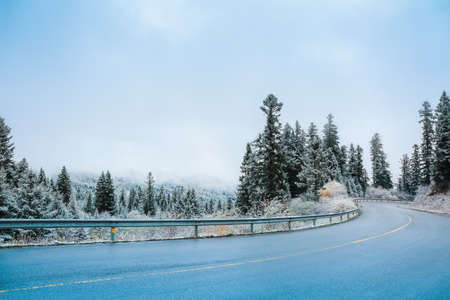 scenic highway: the serpentine road in mountains with snow weather