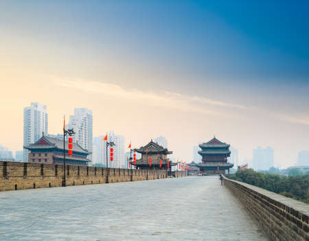 xian city wall with tower at dusk ,chinese famous historical site  photo