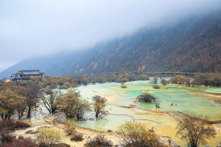 transitional: chinese huanglong scenic area with travertine ponds