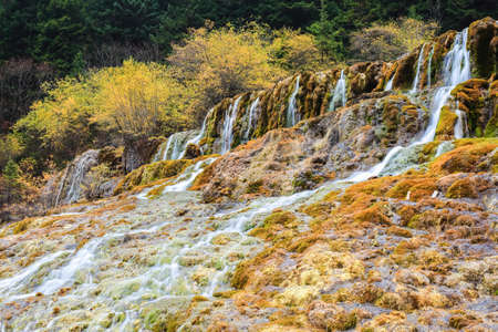transitional: autumn waterfall in huanglong scenic and historic interest area ,China
