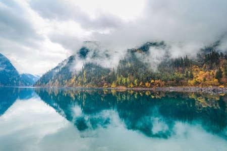 long lake: beautiful long lake at jiuzhaigou,  Jiuzhaigou is a nature reserve famous for its colorful lakes located in the Tibetan-Qiang, Sichuan,China.  Stock Photo