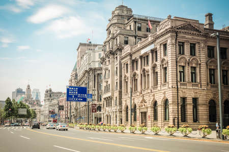 pilasters: old buildings with modern street in shanghai bund,China  Stock Photo