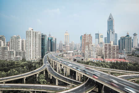modern city skyline with interchange overpass and elevated road junction in shanghai
