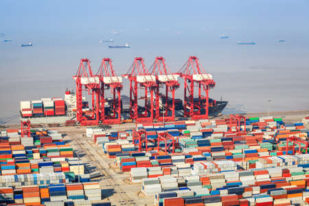 foreign trade: closeup of the container terminal, a busy shipping and port machinery background