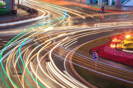 roundabout: car light trails on the roundabout road at night  Stock Photo