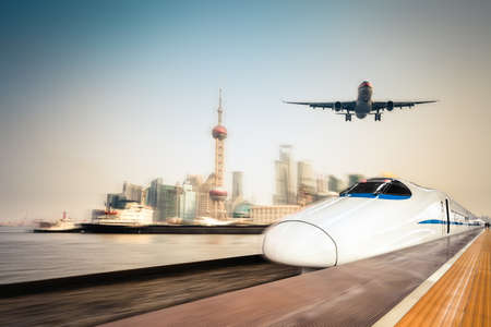 high speed train, airplane and cargo ship with dynamic motion blur background of the shanghai skyline
