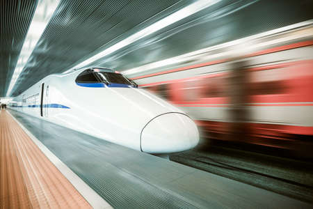 bullet train: high speed train passing station  Editorial