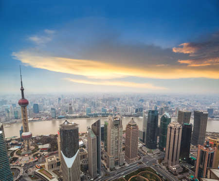 financial world: aerial view of shanghai at dusk with sunset glow