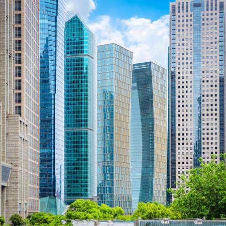 modern office buildings on sunny sky in shanghai financial center Editorial