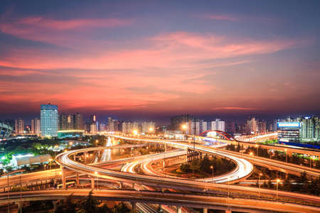 modern city interchange in nightfall , beautiful overpass in shanghai  photo
