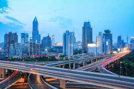 beautiful shanghai skyline with highway traffic at dusk Imagens - 25458756