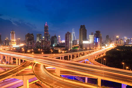 city highway traffic in nightfall,interchange overpass and elevated road at shanghai Imagens