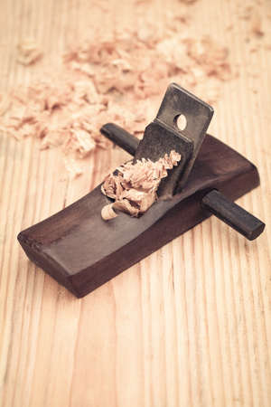 wood planer: carpentry of wood planer and shavings closeup,carpenter concept