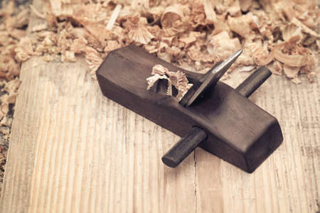 wood planer: carpentry concept of wood planer and shavings