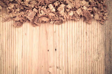 old wooden board with woodchips background photo