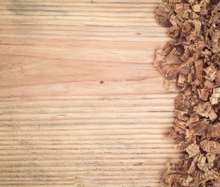 wood shavings: woodchips on old wooden fir board background   Stock Photo
