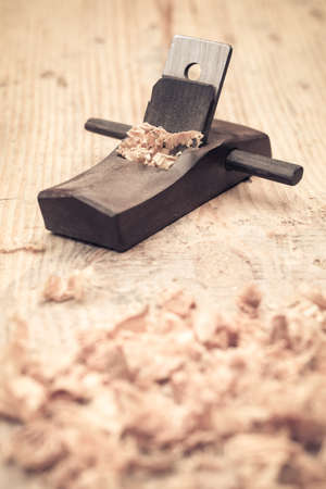 wood planer: small wood planer and shavings closeup,carpentry concept background